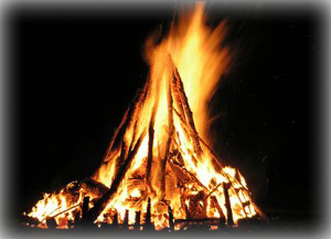A bonfire lighted up on Guy Fawkes Night