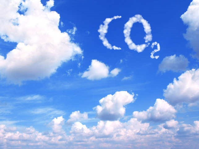 Clouds in the sky reading CO2. Representing environmental impacts.