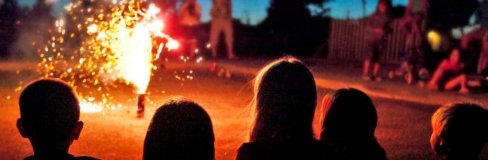 Children watching fireworks in the back garden. Perfect for self-isolation during Coronavirus.