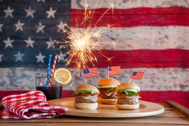 Mini burgers specially for 4th July with American Flag behind